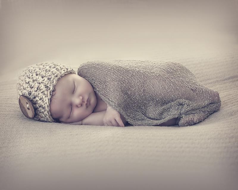 Fotografia final de newborn com retoque realizado por Altair Hoppe.