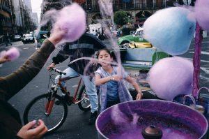 MEXICO. Mexico City. 2003. Cotton candy being spun at the Zocalo.