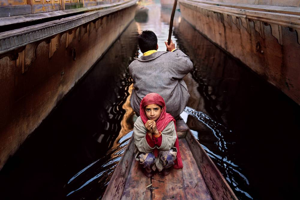 Srinagar, Kashmir, 1996, KASHMIR-10015. CAPTION: Father and daughter on Dal Lake. Srinagar, Kashmir, 1996. MAX PRINT SIZE: 40X60 IG: A girl and her father go to the floating vegetable market in their shikara in Srinagar. Much of the city is surrounded by Dal Lake, where thousands of people use these canoe-like boats to go to and from their homes. Father and daughter on Dal Lake. Srinagar, Kashmir, 1996 -India Book (pg. 199) A girl and her father go to the floating vegetable market in their shikara in Srinagar. Much of the city is surrounded by Dal Lake, where thousands of people use these ˇÌ IPhotoshop 3.0