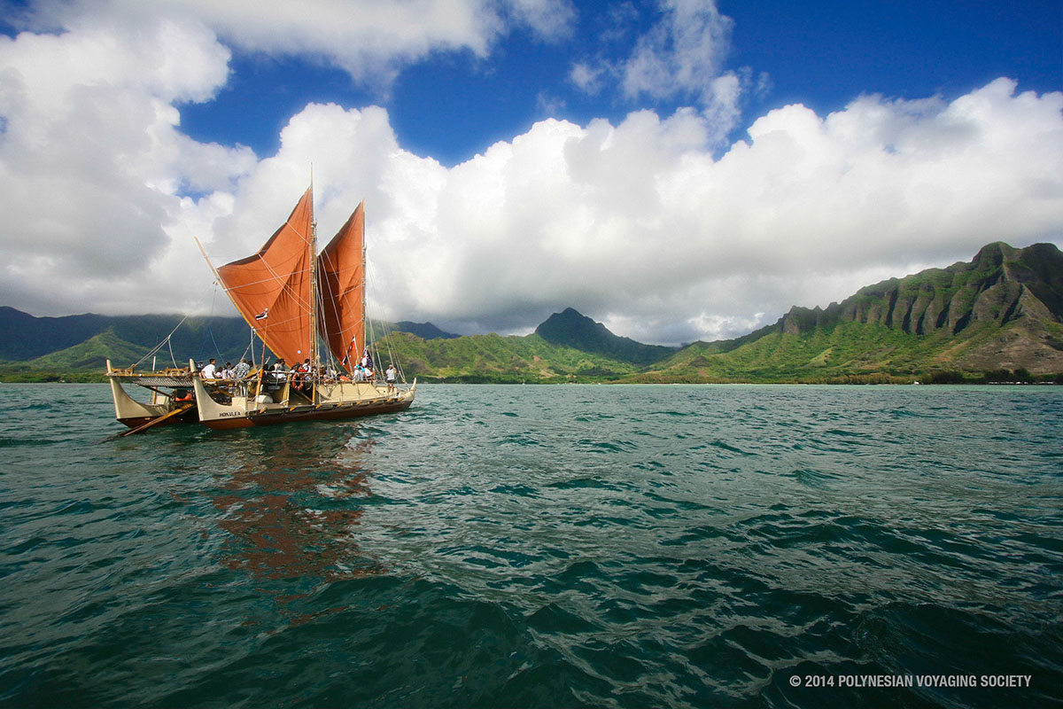 The day breaks over Hōkūleʻa with Kualoa behind her. Photo Courtesy of the Polynesian Voyaging Society.