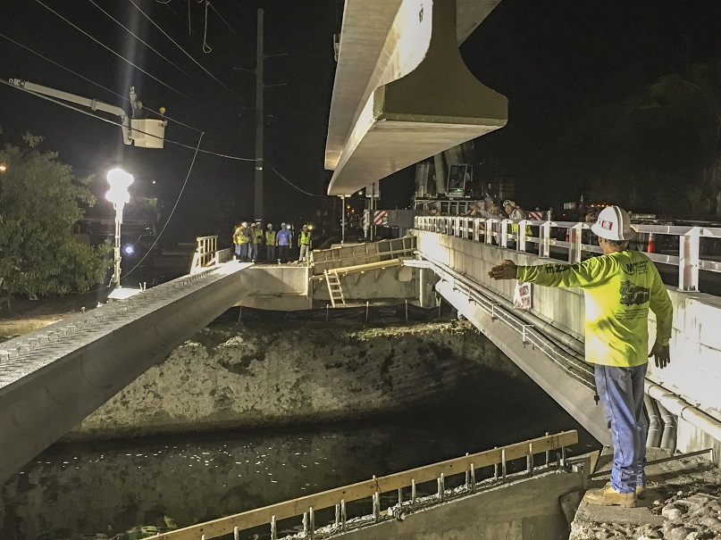 Crews worked in the wee hours of the morning to place two 120-foot, 108,000-pound beams over Marvin D. Adams Waterway in Key Largo for a new pedestrian bridge.