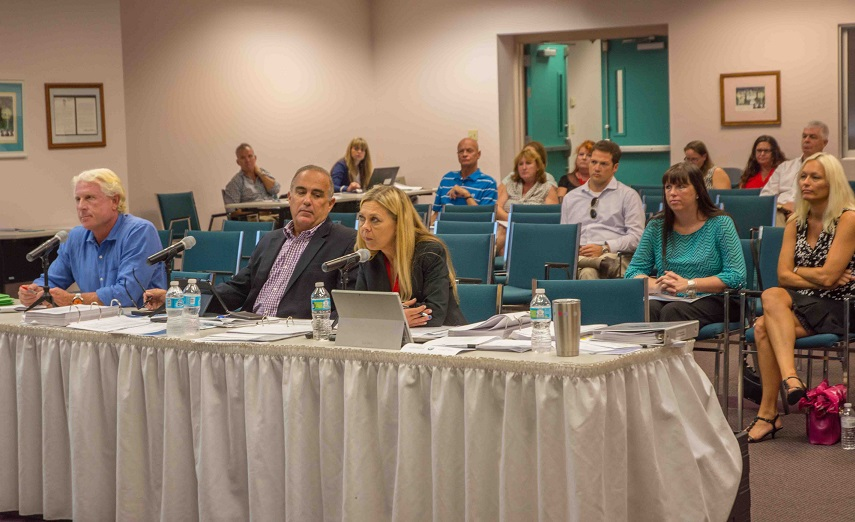 Monroe County Budget Director Tina Boan speaks at BOCC budget hearing with County Administrator Roman Gastesi (center) and Medical Examiner Dr. Thomas Beaver next to her at Harvey Government Center in Key West.