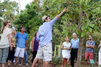 Patrick B. Garvey educates a group of Grimal Grove visitors about the 2 acre property currently in the process of being transformed into a tropical edible park and community resource by the non-profit Growing Hope Initiative organization, founded and directed by Garvey.