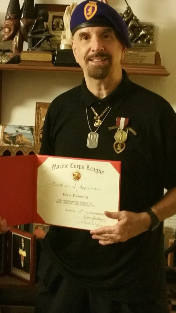 john-donnelly-with-marine-corp-award
