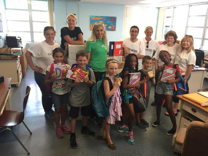 United Way of the Florida Keys Board Chair, Maria Jones, and volunteer, Sarah Taylor, distribute school supplies to Marathon Middle and High School.