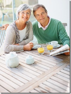 Senior couple having a casual talk at the breakfast table