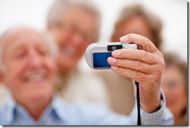 Selp portrait - Macro blur of older people taking picture