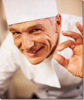 Smiling chef with positive gesture