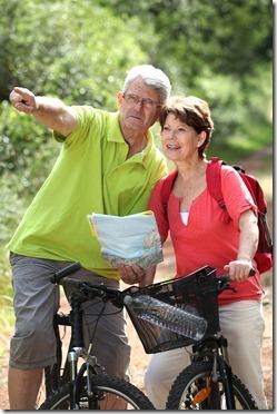 retired couple riding bikes