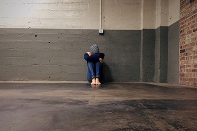 Homeless Person in Empty Building