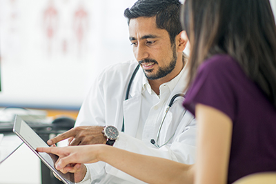 Doctor with Patient on Patient Portal