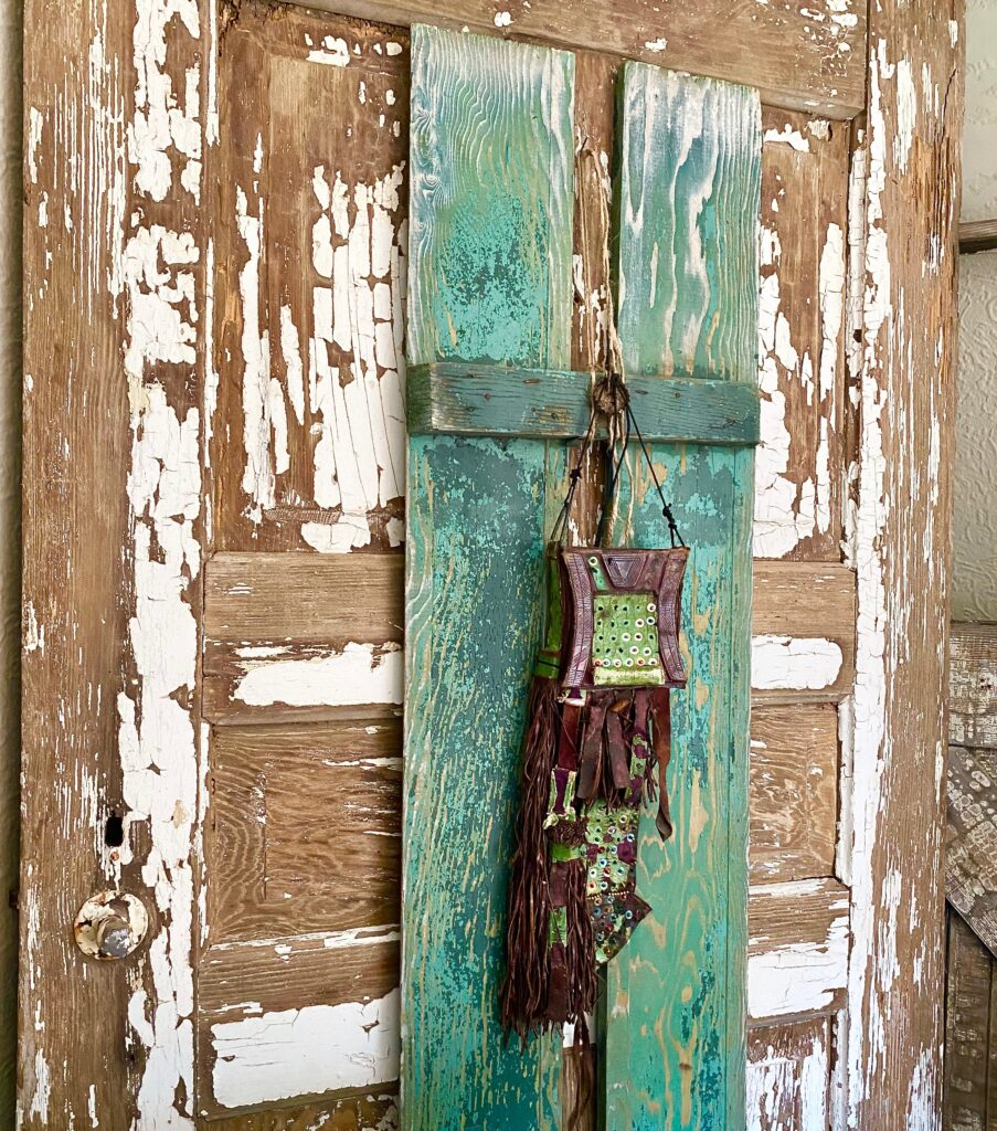 Old chippy white painted door and rustic green shutter.