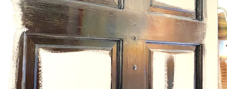 Painting the inside of our front door black.