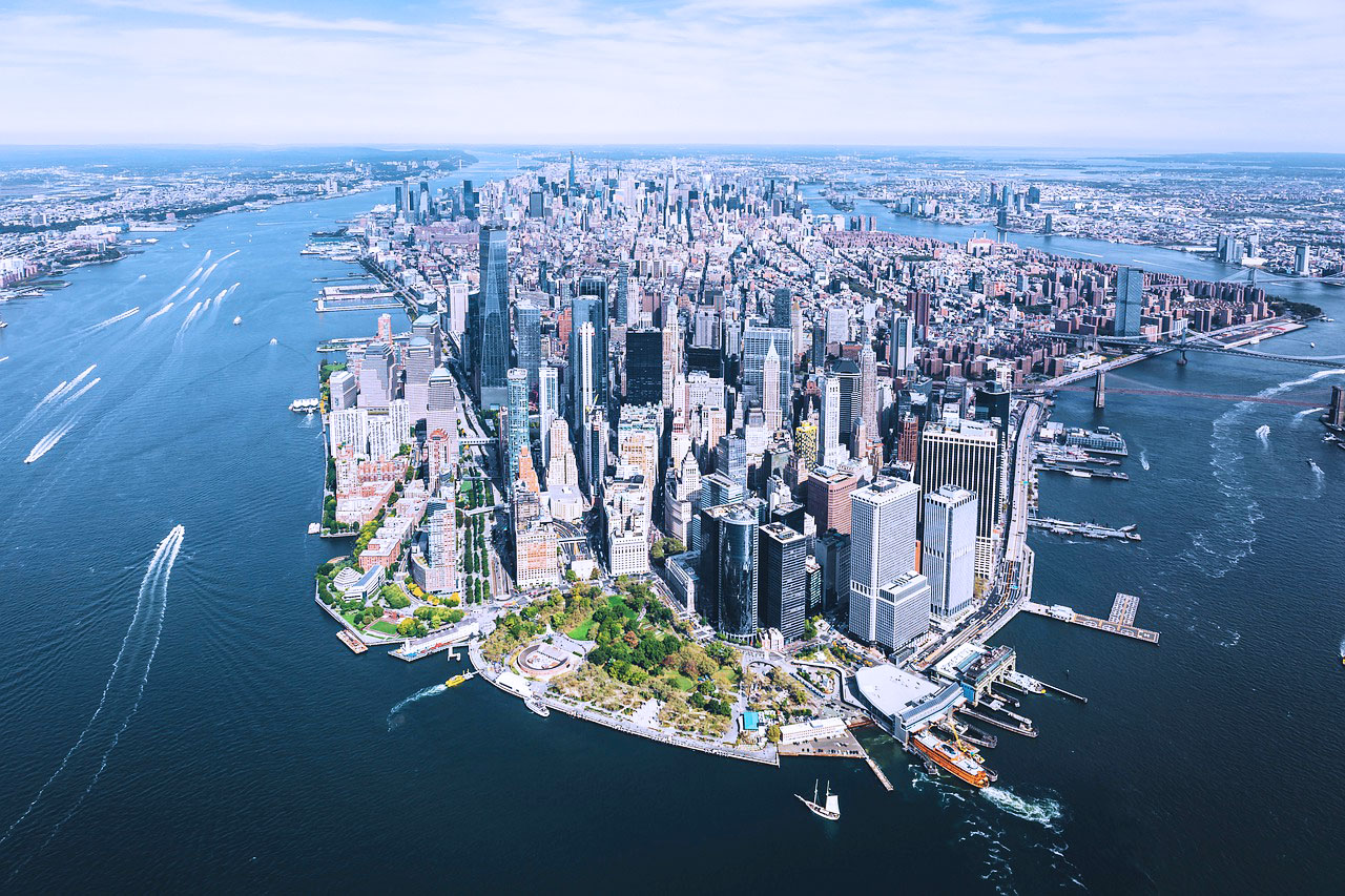 An aerial photo of New York City with buildings and water