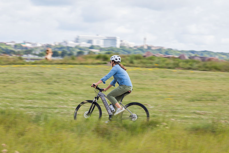 Trek 2019 Dual Sport+ e-bike, woman riding off road