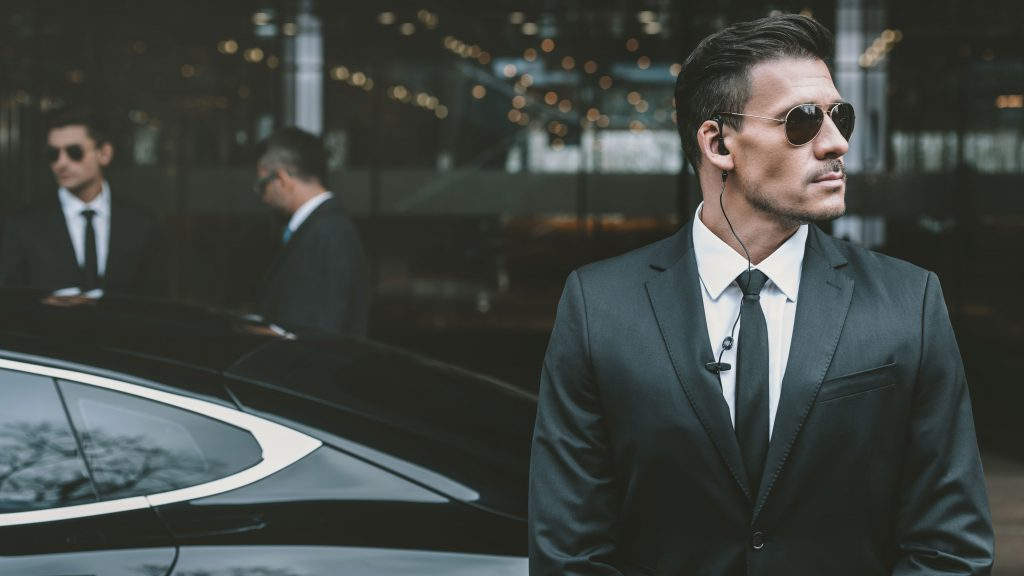 Private security guard in suit and dark glasses