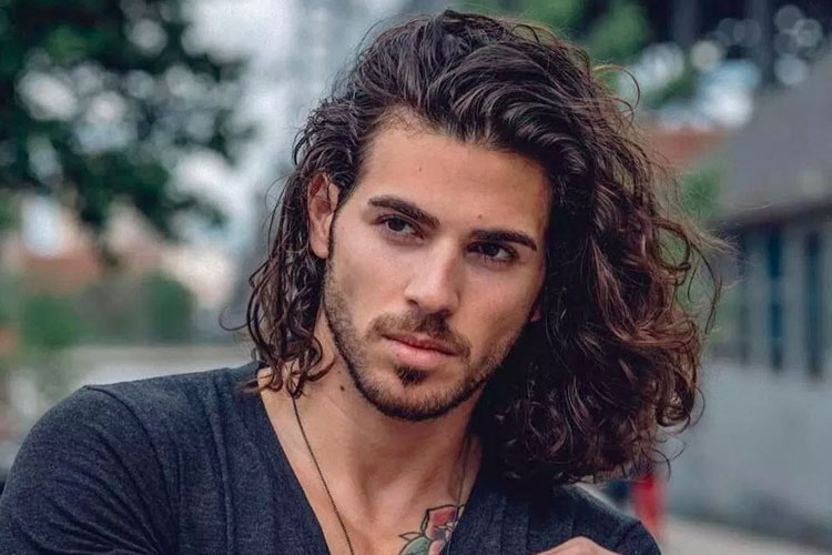 Man With A Long Curly Hair