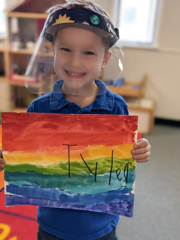 My son at school with artwork