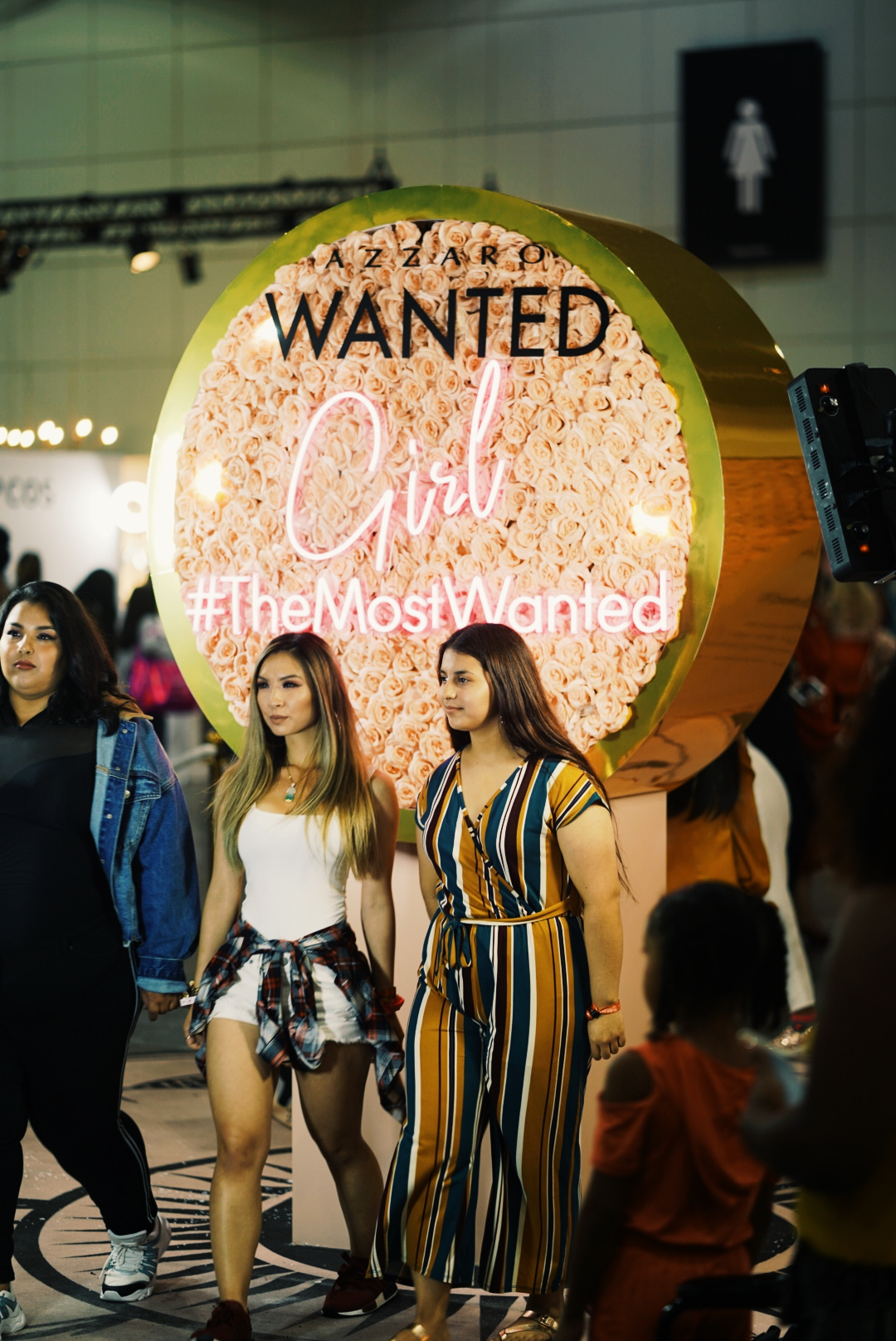 Two Girls Posing for Interactive Beautycon tradeshow booth