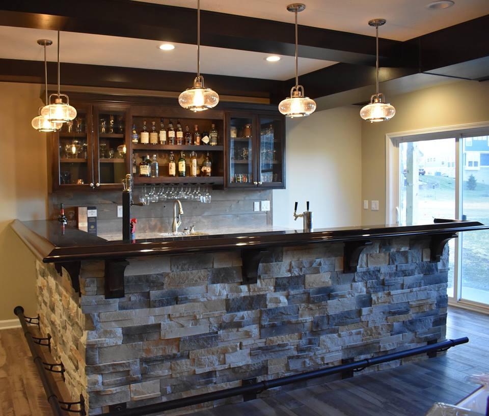 Basement wet bar with custom bar top.