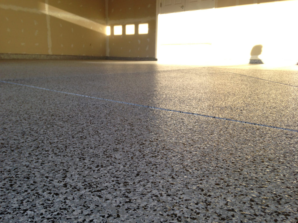 We love the adaptability of our One Day Coatings product line. It is perfect for all types of applications and can lasts in the harshest types of environments. This image shows another Vinyl Chip System installed in a garage. This is perfect for home owners who want to boost the value of their home while making their garage space safer and look a whole lot better!