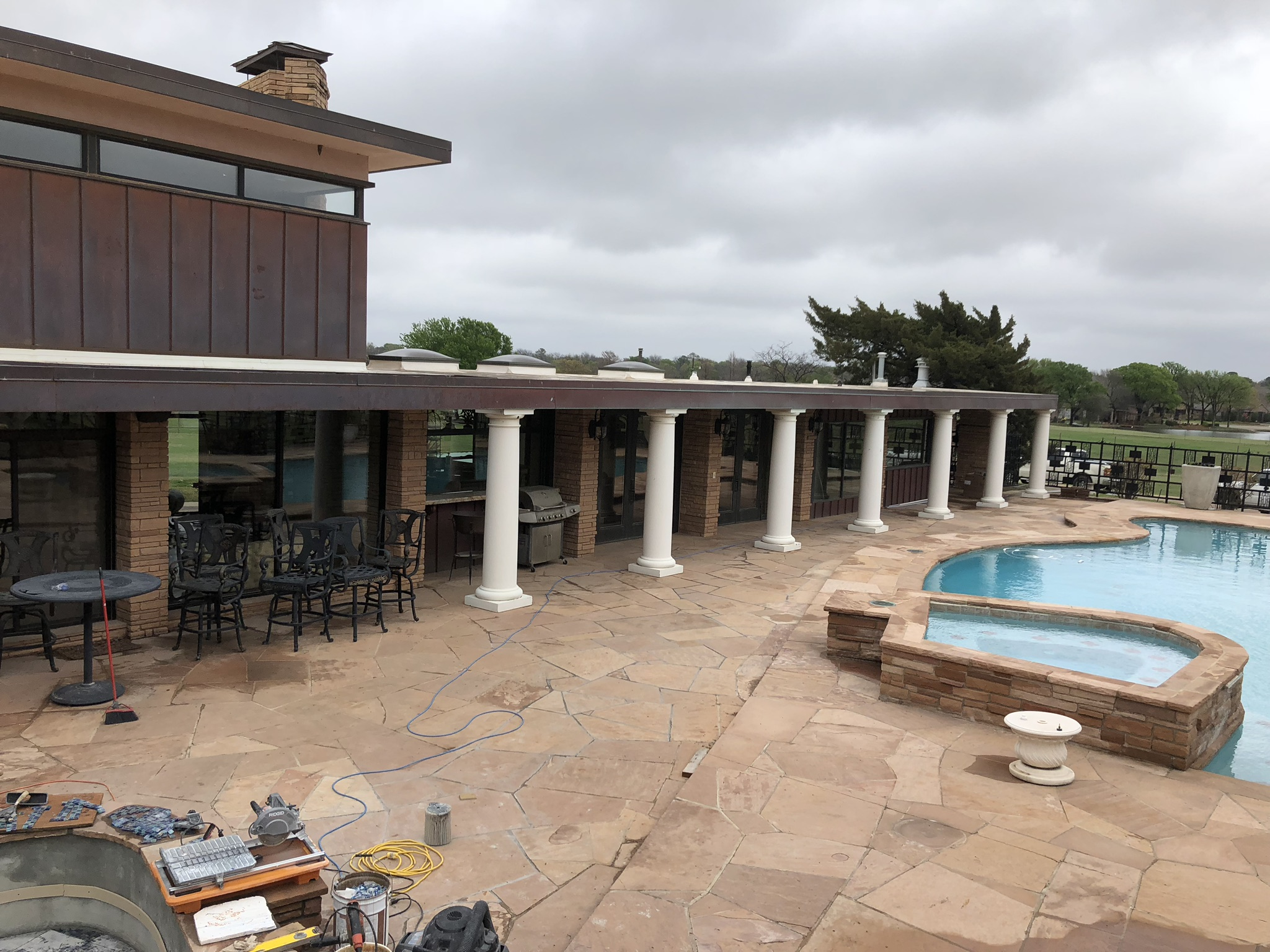 This renovation job required us to remove large portions of decking to run new lines of plumbing. Our equipment was located in a storage room, on the right side of this home. This was approximately a 100' run from the equipment to the elevated water fountains that we installed.