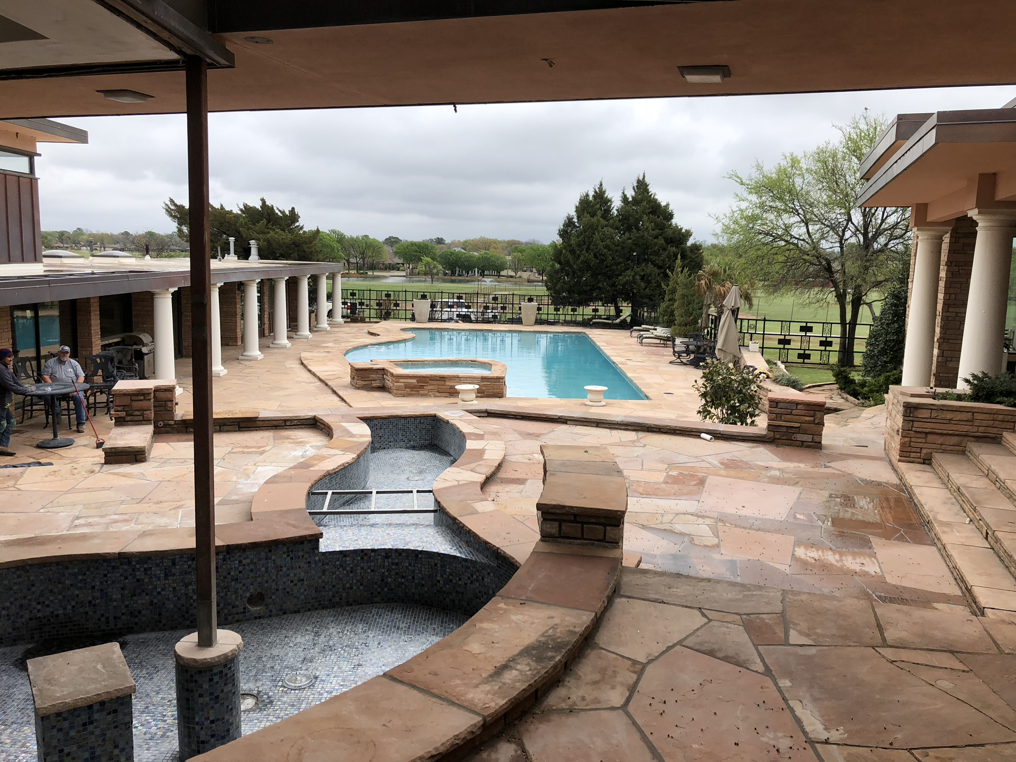 Here is one last look at this gorgeous backyard setting. As you can see from this image, there are going to be two elevated water features that run down to our pool. These water features will not be connected, but instead will have a catch basin and run on their own closed plumbing loop.
