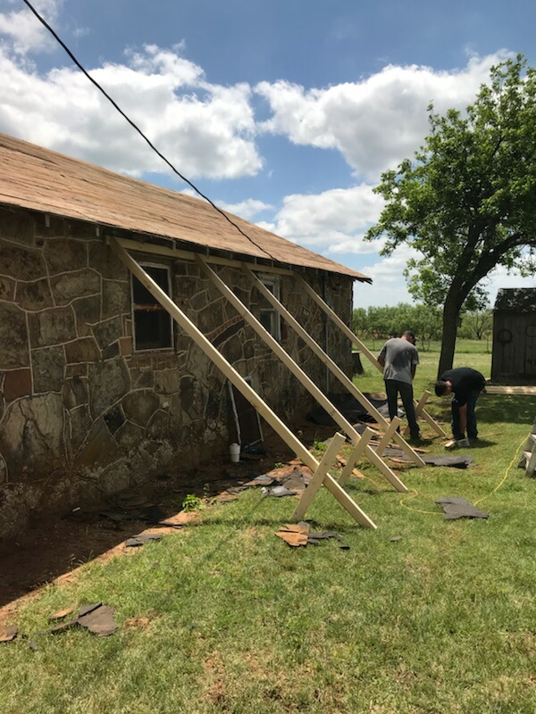 """Our team is utilizing """"bracing"""" to provide support around this structure. Due to the age of the home, this is merely a precautionary measure. When we remove the roof, the structure will be less stable so we want to provide as much support as possible. This structure has stood for over 73 years - it's not going anywhere on our watch!"""