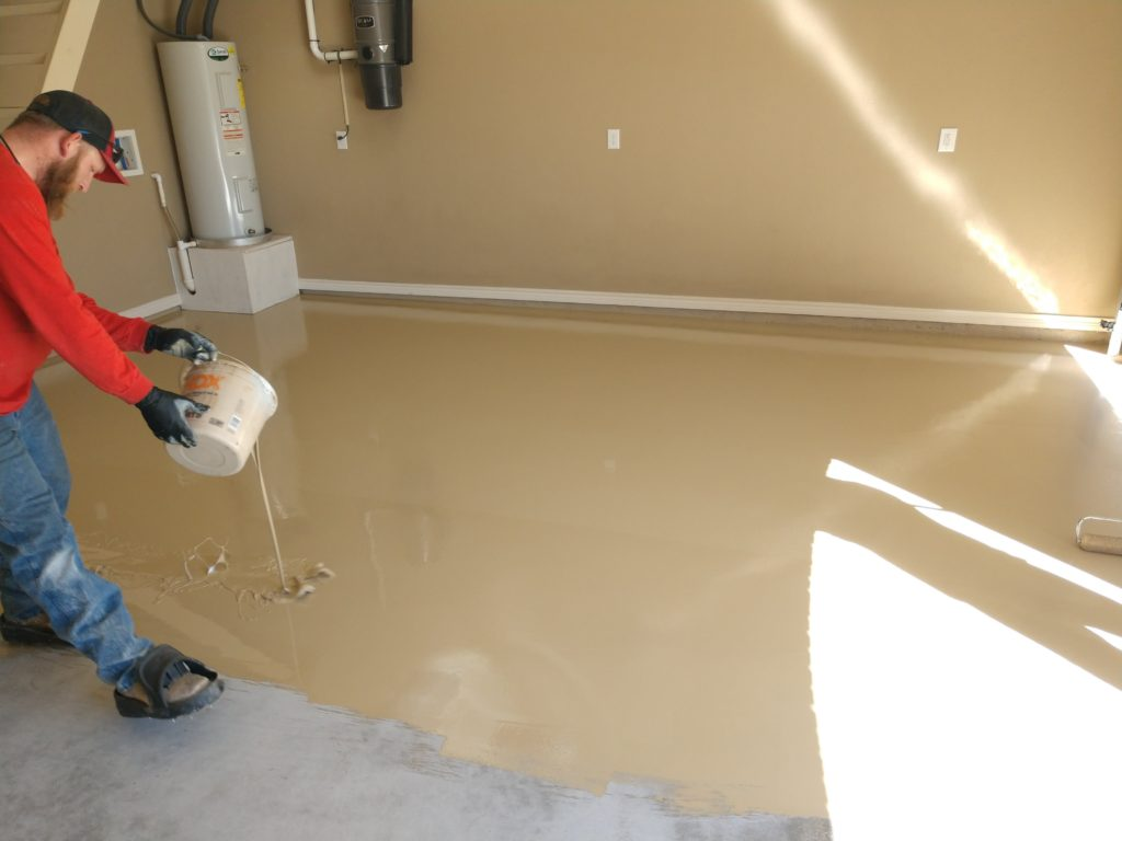 Lastly, we apply our Polyurea Primer / Basecoat. We also use a roller brush to help distribute this material evenly across your floors. Once the surface is smooth and even, we apply the Vinyl Chip flakes to complete our 1 Day Coating installation.