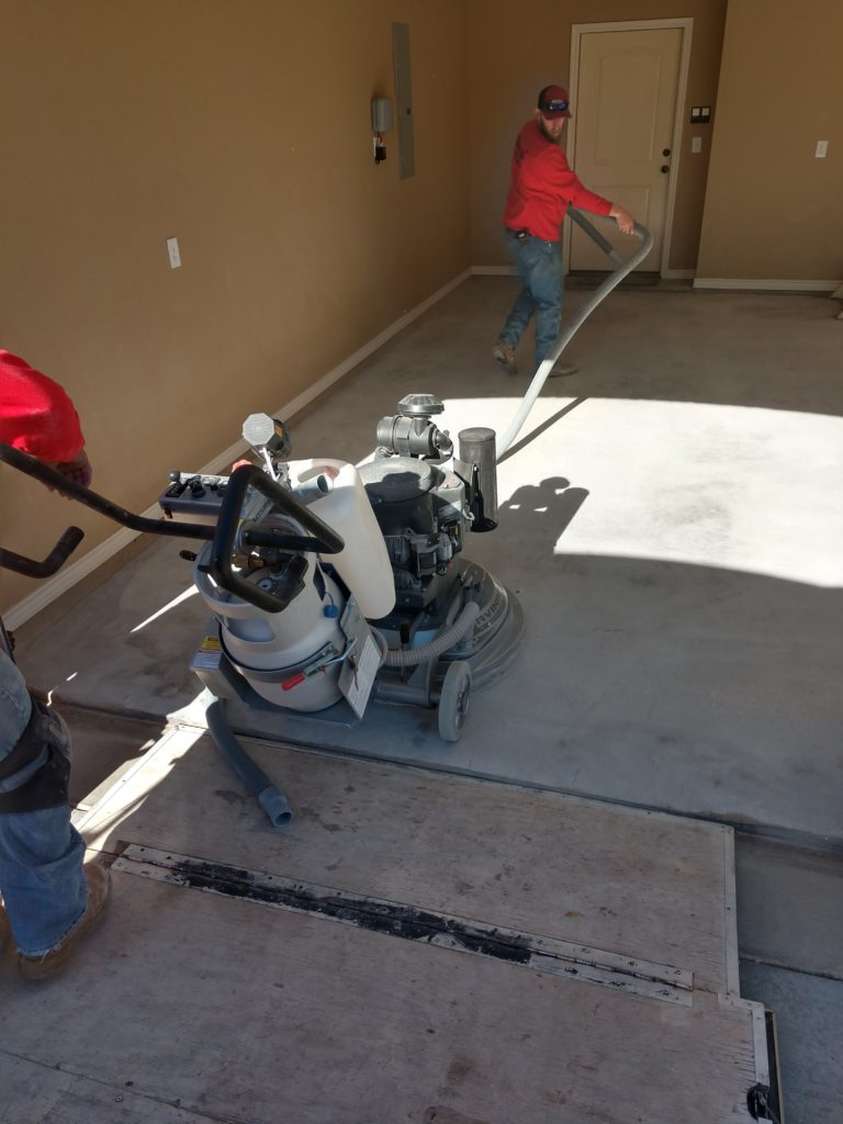 We use some commercial sanding & buffing equipment to purge our garage floor of dust and debris. This removes our top layer of concrete to expose a fresh layer that we use to apply our Polyurea bond coat. Preparing our floor is the most crucial part of the 1 Day Coatings process and is the stage where we spend most of our time. This must be done correctly to ensure proper bonding between our Vinyl Chip system and your garage floor.