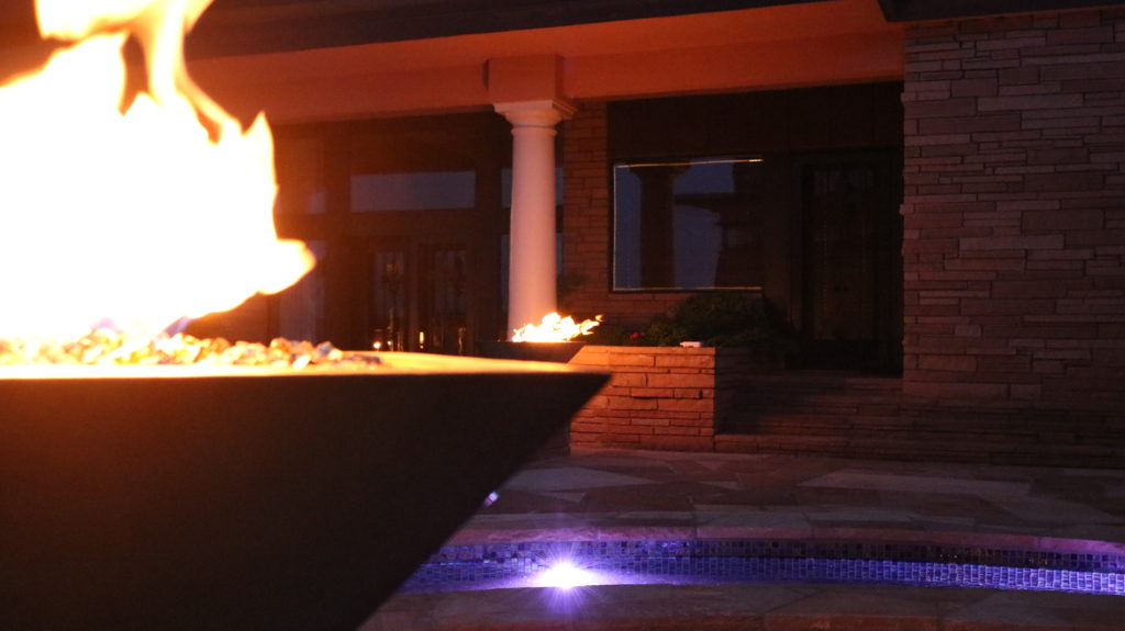This image shows our two Maya Fire Bowls that we custom designed with a copper patina finish! This project is entirely 100% custom and showcases our ability to create any backyard landscape that you can imagine. These fire pits can be controlled from a wireless handheld controller by our amazing Smart Controller technology!