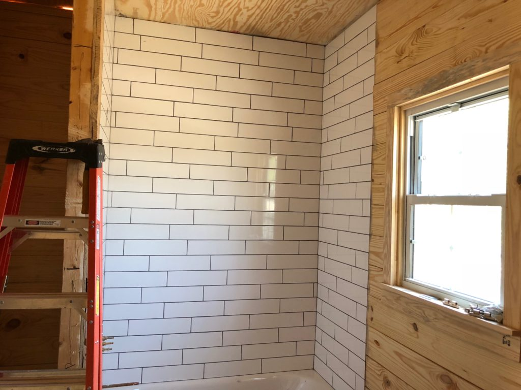 Part of our job involves building a beautiful bath tub & shower with classic white subway tiles. Here you can see we've installed the tile and are allowing the thin-set to dry & bond the tile to the wall.