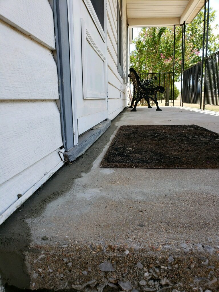 Alas, now that we've elevated this home back to level and patched it with new concrete, the effect of the foundation shifts is nearly invisible (aside from the wet concrete). Our client now has a foundation that is protects their home and property value.