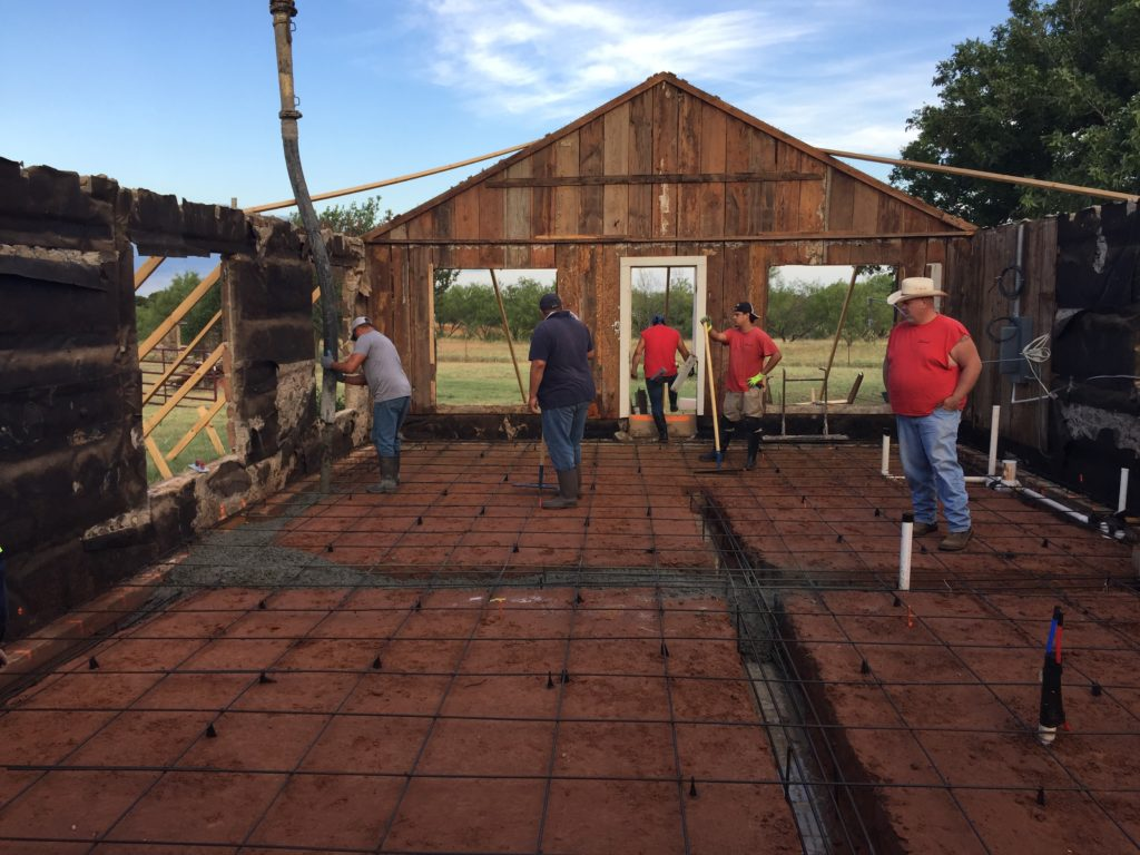 Part of our renovation process involves fixing the foundation and creating a whole new concrete slab for the base of the home Our crews are seen here framing our groundwork and pouring our concrete material. This is arduous work but paramount to the future health of the home.