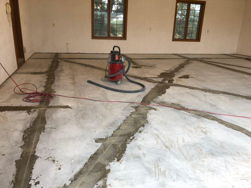 This image is a great example of the care in the pre-installation process that we follow. Our crews work diligently and carefully to power wash, clean and vacuum your surface. Secondly, we look for any cracks and fill these cracks before applying our basecoat.