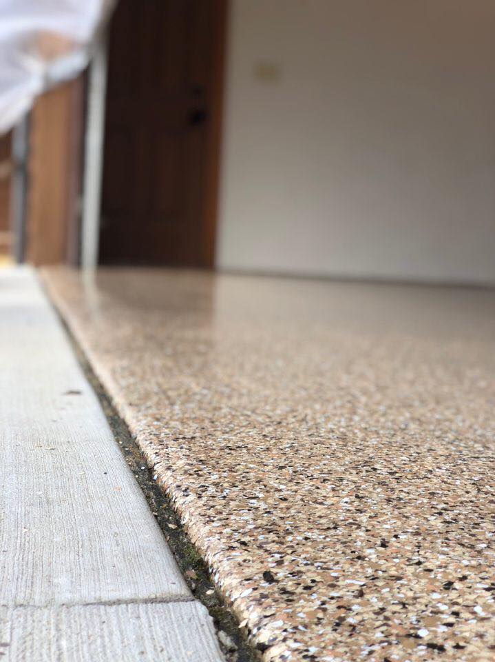 Our teams take great care to ensure we create a seamless transition from our 1 Day Coatings product to your drive way. This image illustrates the beautiful edge work that we can do with our industrial floor coatings. Beautiful!