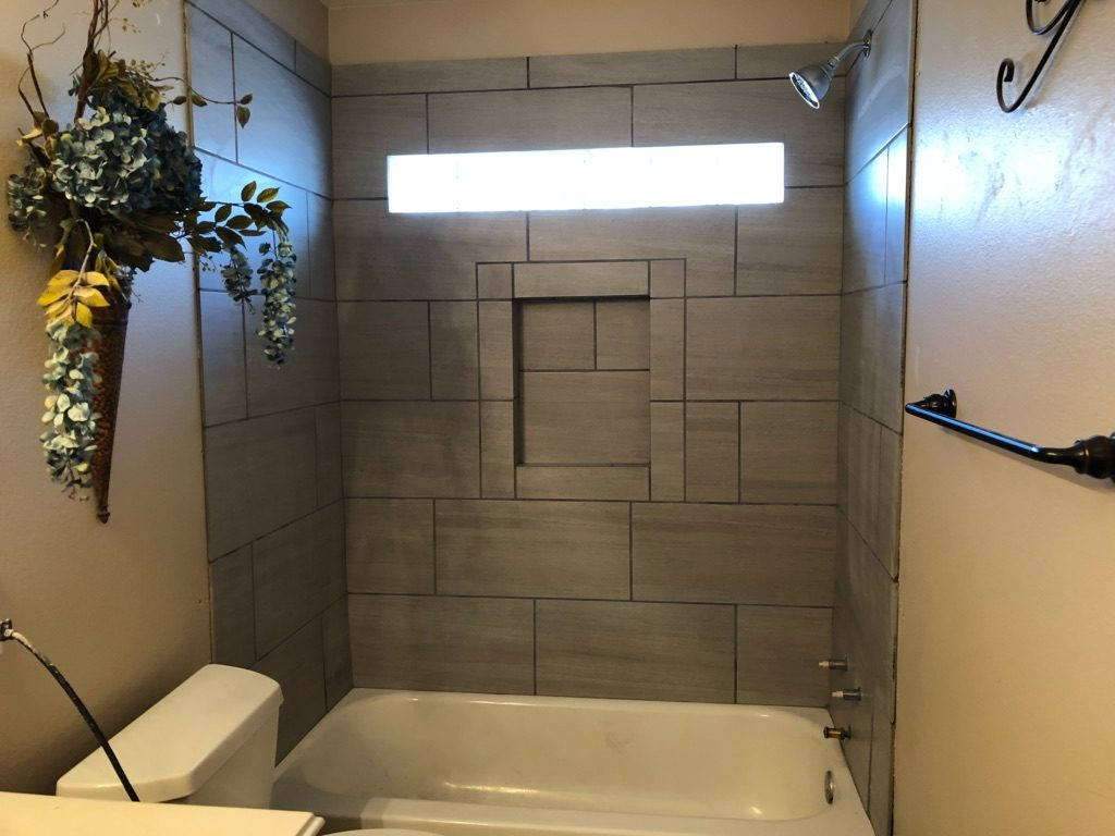 We just completed a brand new bathroom remodel. This job entailed replacing the shower & installing a completely new tile floor. Let's roll up those sleeves and see how we made it happen!