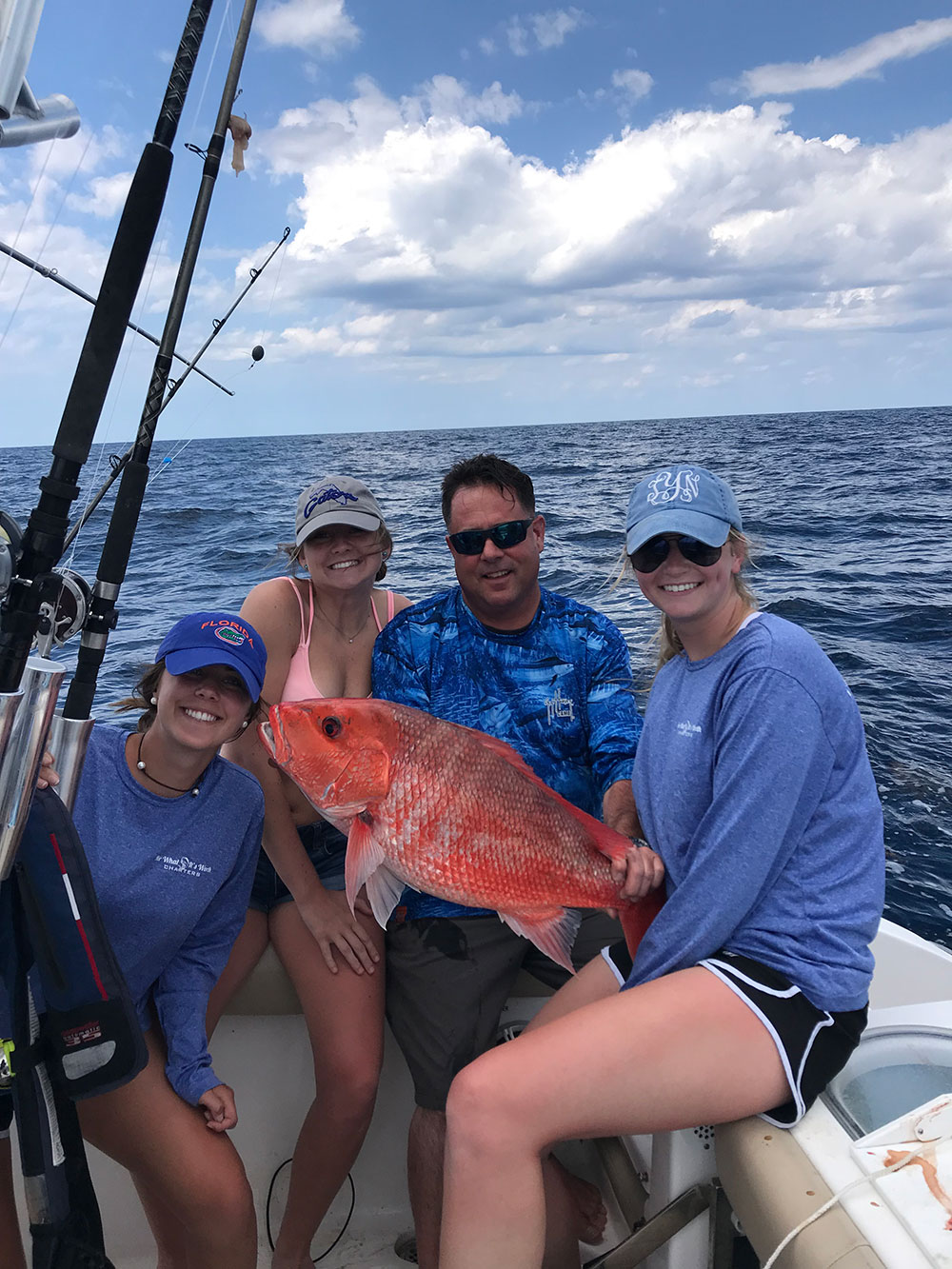 Chris Worth and three ladies showcasing red snapper catch