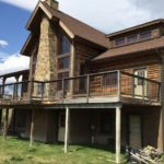 Beautiful log home with large  windows looking out over North Meadow Creek
