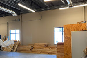Large workshop space with lumber and other building supplies.