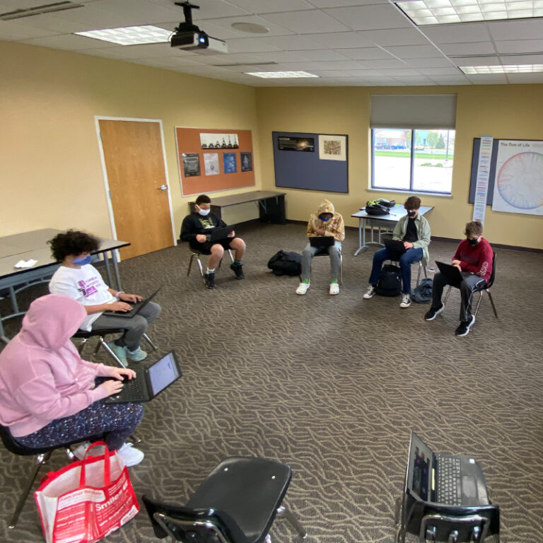 Students in a circle having class.