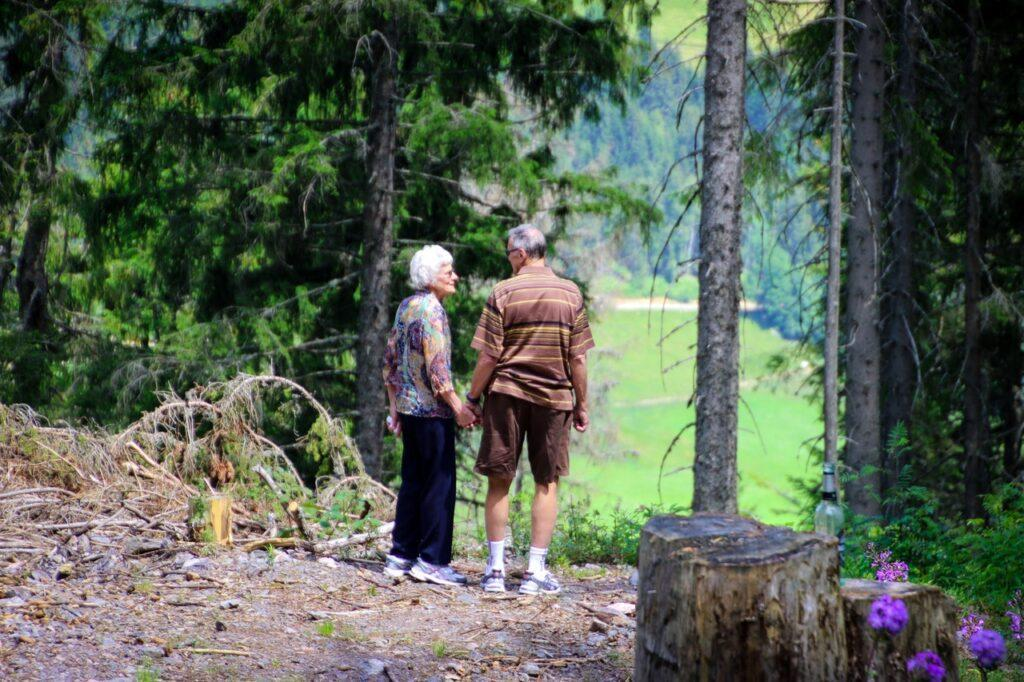 a pair of elders walking in the forest