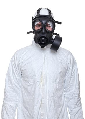 Coronavirus Cleaning / biohazard clean-up man with gas mask