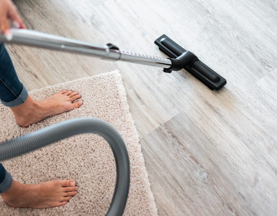 woman-using-a-vacuum-cleaner-at-home