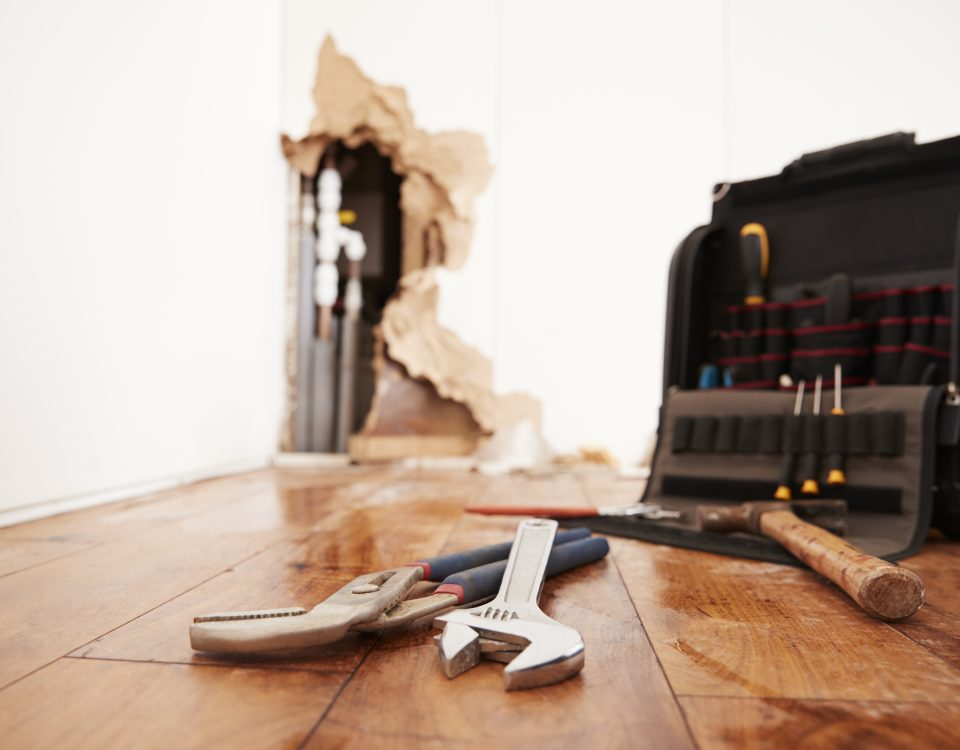 Tools and toolbox lying on flood damaged floor