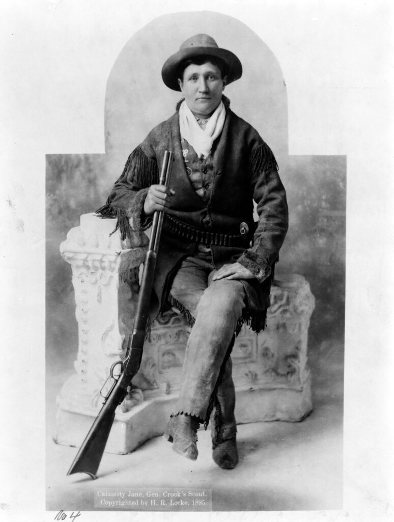 Martha Canary Calamity Jane_ full-length portrait, seated with rifle as General Crook's scout 1895 LOC