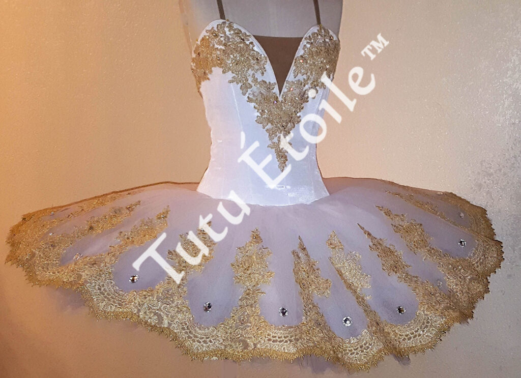 White with gold lace trim
