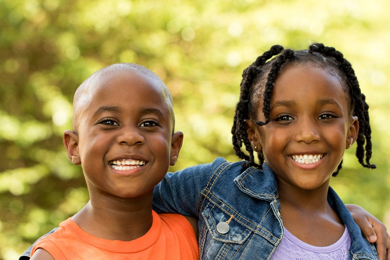 children smiling at camera