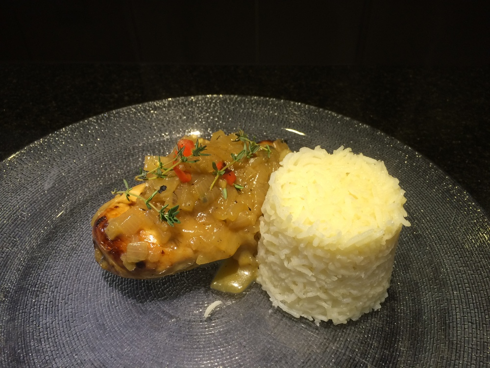 Poulet Yassa is one of Senegals most popular dishes which features lemon-marinated grilled chicken simmered in a spicy onion sauce.