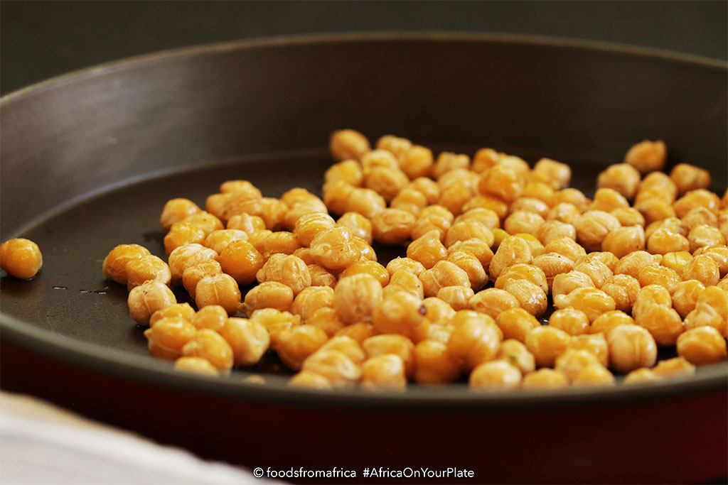These Oven-roasted Chickpeas are the ultimate healthy snack - black-speckled golden and crispy balls with a buttery interior and a spicy kick